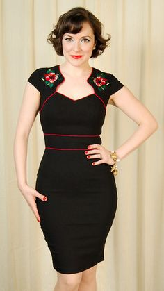 Hibiscus Pencil Wiggle Dress:This is a classic style dress with an edgy twist. It's a fitted black wiggle dress with red piping at the waist, bust and collar. It has embroidered hibiscus flowers on the shoulders, cap sleeves and a center back zipper and slit at the bottom center hem in the back. It's super stretchy to hug all your curves too! 75percent... $76.00