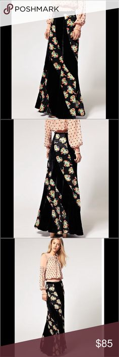 "Free People Velvel Floral Maxi Skirt S38-Free People Twisted Velvet Floral Maxi Skirt. Crafted in a velvet fabric and floral print. Featuring a high, fitted waist with a wide waistband, contrast panel design, fluid style and a maxi cut. Side zip closure & hook & eye. Flat across @ waist: 15"", lenght: 34"". NWOT Free People Skirts Maxi"