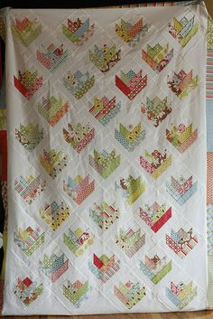 Floral Bouquet Quilt ~ LOVE this! Verna Jelly Roll and Kona Snow. From book Jelly Roll Quilts.