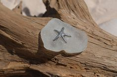 Frosted white sea glass magnet with a starfish.