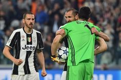 Juventus' goalkeeper from Italy Gianluigi Buffon, Juventus' defender from Italy Giorgio Chiellini and Juventus' defender from Italy Leonardo Bonucci celebrate during the UEFA Champions League quarter final first leg football match Juventus vs Barcelona, on April 11, 2017 at the Juventus stadium in Turin.  / AFP PHOTO / GIUSEPPE CACACE