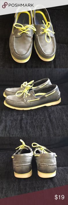 Sperry boat shoes Muted navy almost gray in color Sperry boat shoe with lime green shoe strings. Have been well loved. Show some signs of wear. Rubber not as bright as when purchased. Sperry Top-Sider Shoes Boat Shoes