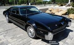 1966 Oldsmobile Toronado - MT Car of the Year and America's first front wheel drive car. Has styling cues from the '30's Cords.