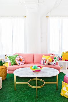 Playful lounge and living area with a grass green rug and pink couch. Love the donut pillow and marble and brass coffee table! Colourful Living Room, Living Room Green, Living Room Carpet, Bedroom Carpet, Living Room Decor, Dining Room, Pink Couch, Green Pillows, Throw Pillows