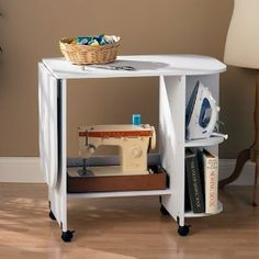 LOVE LOVE THE IRONING BOARD/SEWING TABLE IDEA!!!!.wonderfull for a small space