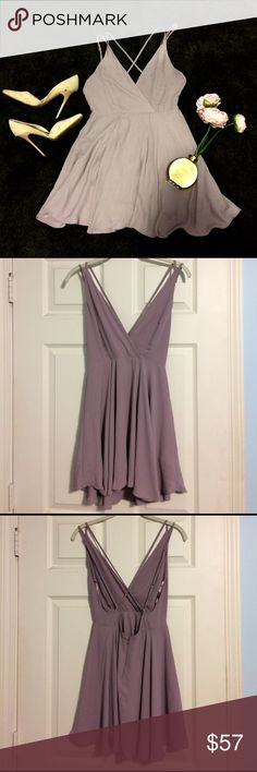 Purple chiffon kimichi blue dress urban outfitters NWOT. I LOVE LOVE LOVE this dress and am sad to let it go, but it doesn't fit me right anymore. It is a dusty purple chiffon dress, from Urban Outfitters kimichi blue. Strappy crossback and zip up skirt. Such a pretty dress. Looking to find this in medium. Still selling it in small. Never wore it anywhere but tags were removed. ❌no trades ships same or next day except weekends Urban Outfitters Dresses