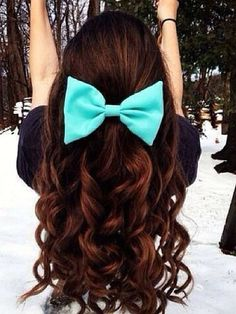 My graduation hair style. The bow matches my dress.