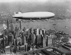 The German airship Hindenburg flying over Manhattan Island in New York, 1937.