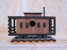 Caboose birdhouse made from pine and oak pallets. Great indoor / outdoor decoration can be made with or without a bird hole. Made for small birds