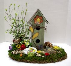 Whimsical basswood arrangement designed by karen b a c for Michaels craft store erie pa