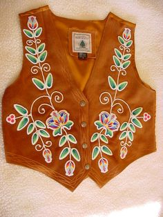 Vintage suede vest turn Native Amerian beadwork masterpiece! Floral beadwork finished in 13/0 cut glass beads. LOVE FLORAL BEADWORK SOLD