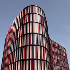 Oval Offices, Cologne, Germany, by Sauerbruch Hutton --- Panels on the exterior façade as well as a series of roof gardens insulate the buildings. While the glass and glazed corridor skins control natural light penetration, operable windows allow each occupant control over internal ventilation. The colored louvers are adjustable, providing different levels of sun shading based on time of day.