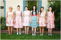 Cute pattered bridesmaid dresses in contrast to the bride with a turquoise dress and coral shash