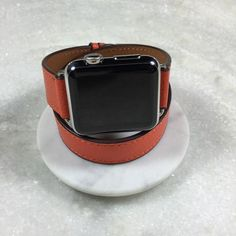 Textured Leather Summer Orange Double Wrap Apple Watch Band by Juxli Home. Handmade, stylish leather strap with rose gold hardware on a Apple watch on a canvas with a black and gray painting. Apple Watch Leather, Rose Gold Apple Watch, Apple Watch Series 2, Apple Watch Bands, Apple Watch Fitness, Apple Watch Iphone, Watches For Men, Orange, Summer