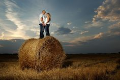 Love this idea for a photo! Couple on Hay. Country Engagement Pictures <3