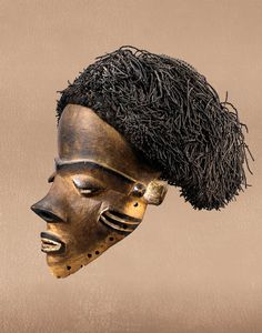 Africa | 'Mbuya' mask from the Pende people of DR Congo | Wood, Kaolin, fiber | ca. early 1900s.