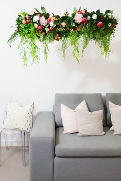 No matter what your style, there's a DIY chandelier that will make your space feel just a bit more festive. Chandelier Planter, Wood Bead Chandelier, Flower Chandelier, Chandelier In Living Room, Faux Flowers, Diy Flowers, How To Make A Chandelier, Cool Chandeliers, Weekend Projects