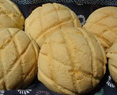 Melon pan ~ A soft, sweet roll encased in cookie dough and scored to resemble a melon