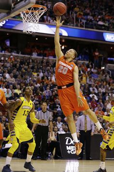 Syracuse guard Brandon Triche (20) heads towards the basket as Marquette guard Vander Blue (13) watches during the first half of the East Regional final in the NCAA men's college basketball tournament, Saturday, March 30, 2013, in Washington.