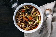 A surprisingly easy dried porcini broth plus a mix of fresh wild mushrooms gives this soup its rich flavor and stunning look.