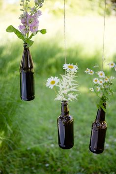 Daisies in bottles. Would use old wine bottles for a touch of class instead and for a tree that hasn't bloomed yet.