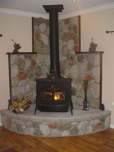 Like the set-up, not the color of stones or trim. Corner wood burning stoves - Google Search