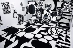 A bold, graphically appealing exhibition by Emil Kozak featuring black and white ink drawings and serigraphs.
