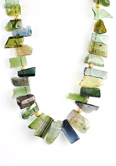 Greig Porter 1 Strand Slab Tourmaline Necklace ~ Tourmalines come in a a wide scope of color The green Tourmaline (Verdelite) shown here brings joy to life, by promoting an appreciation for the many wonders that life has to offer. It also encourages patience and openness, as well as sincere interest in fellow human beings. Thought to have magic, to some, tourmaline is said to stimulate creativity. Green tourmaline and strengthens the heart.