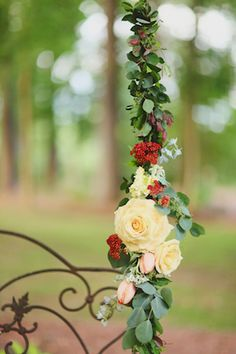Flower garland on swing | J. Woodbery Photography | see more on: http://burnettsboards.com/2014/09/classic-southern-wedding-inspired-wind/