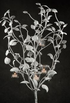 Yule Ball - spray paint leaves and sticks white for great decoration!