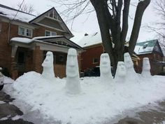 Moai Easter Island Statue Snowmen Decorate the Yard of a Canadian Home. Rather than make snowmen in their front yard, the residents of this house in Waterloo, Ontario, Canada made snow versions of the monolithic moai statues found on Easter Island. Apparently they did the same thing last year as well.    photo by Shawn Huckaby    via Super Punch