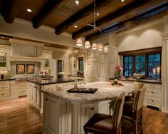 Wood beams on the ceiling and TWO islands
