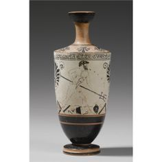 AN ATTIC WHITE GROUND LEKYTHOS, CIRCA 490-480 B.C. painted in black and brown wash with Herakles destroying the house of Nereus with a trident, broken vessels on the ground, the inscription KALOS in the field, a linked palmette and lotus flower at left, a double palmette at right, meander below the shoulder, linked palmettes on the shoulder, tongues below the neck.