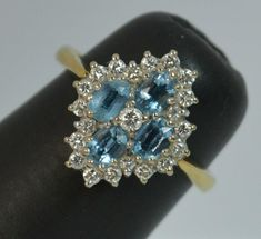 Beautiful 18ct Gold Aquamarine and Diamond Cluster Ring d0441 #Cluster #Engagement