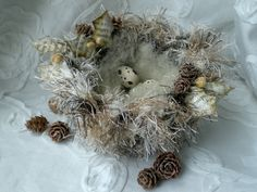 From Todolwen.blogspot.com.  She made this Winter Nest - love it!