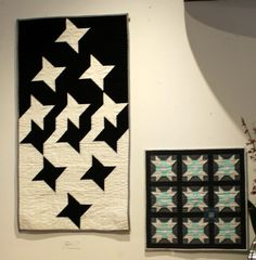 """Last Friday, a new exhibit went up at Island Quilter ! And that would be """"Modern Solstice"""", an inspiring collection of star quilts from the..."""