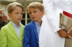 Twin brothers Prince Aymeric and Prince Nicolas hide behind their mother, Princess Claire of Belgium. Aren't they cutie pies?