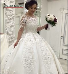 Item Type: Wedding Dresses Back Design: Zipper Built-in Bra: Yes Decoration: Beading,Appliques Silhouette: Ball Gown Model Number: 16102204 Sleeve Style: Regular Brand Name: Amanda Novias Wedding Dres