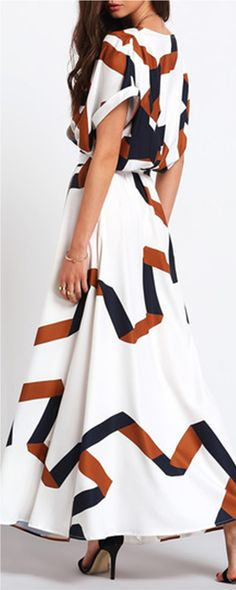Crisp and airy, this short-sleeved maxi dress is in geometric print. It's…