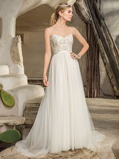 Stunningly intricate beadwork decorates the sweetheart neckline bodice of Style 2296 Piper, juxtaposed with a soft stretch chiffon and tulle sheath skirt, ...