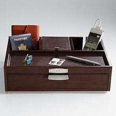 Deluxe Valet Set from RedEnvelope.com makes a great gift for the man who doesn't have a place to put all of his things, and instead leaves them all over the place ;-)