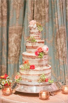 rustic and flower topped nearly naked wedding cake