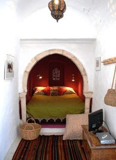 What an interesting layout - the bed is almost a hidden part of this room.