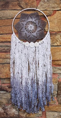 A personal favorite from my Etsy shop https://www.etsy.com/listing/252078819/bohemian-doily-draamcatcher-in-stormy