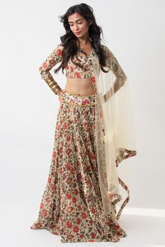 Peach floral net lengha, with embroidered belt and matte gold sequin crop top. Delivery time: Since this piece is made to order, please allow weeks for your outfit to arrive. Included in purchase: Skirt, Blouse & Dupatta Care & composition: Dry Clean Only Sequin Crop Top, Floral Crop Tops, Indian Dresses, Indian Outfits, Indian Clothes, Black Tie Bridesmaids, Indian Wear, Indian Style, Wedding Hair And Makeup