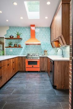 Jan 11, 2019 - This 1950's mid-century home in Yellow Springs, OH was uninhabitable at the time of purchase. Our Interior Designer, Lindsey Engler saw the potential of this home, especially the kitchen. She envisioned creating a funky, colorful, light-filled, mid-century inspired space.  Linds Modern Kitchen Furniture, Modern Kitchen Design, Modern House Design, Recycled Glass Countertops, Patterned Kitchen Tiles, Mid Century Modern Kitchen, Style Tile, Bright, Mid Century House