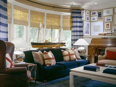 Gold,Navy and Red- Nautical- masculine with the leather chair!  Yet a velvet couch! great dip lay of regatta photos.