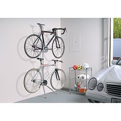 @Overstock - Materials: Powder-coated steel  Number of bikes that can be stored: 2  Mount type: Leaninghttp://www.overstock.com/Home-Garden/The-Art-of-Storage-Donatello-Leaning-Bike-Rack/6415785/product.html?CID=214117 $41.90