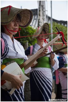 Playing the shamisen--Japan-- Matsuri