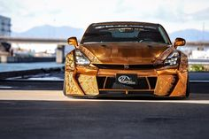 2015 NISSAN GTR by Kuhl Racing >  Kuhl Racing's Crazy Gold Chrome Nissan GT-R Poses